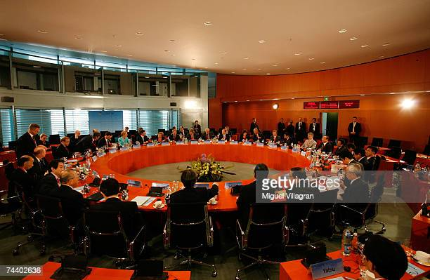 Participants of the EUJapan summit sit at a round table on June 05 2007 in Berlin Germany Delegates include German Chancellor Angela Merkel and...