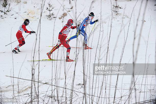 Participants of the FIS World Cup Crosscountry women's Skiathlon 75 km Classic 75 km freestyle event compete in Rybinsk on February 5 2012 Therese...