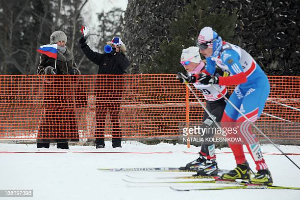 Participants of the FIS World Cup Crosscountry women's Skiathlon 75 km Classic 75 km freestyle event compete as supporters cheer them on in Rybinsk...