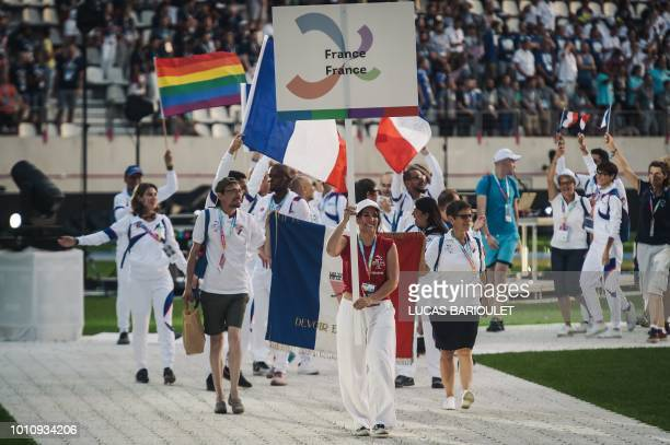 Participants of the French team march onto the field during the opening ceremony of the 2018 Gay Games edition at the Jean Bouin Stadium in Paris on...