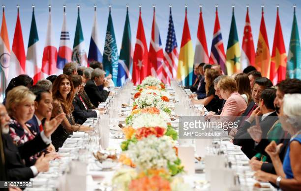 Participants of the G20 summit and their spouses attend the banquet after a concert at the Elbphilharmonie concert hall during the G20 Summit in...