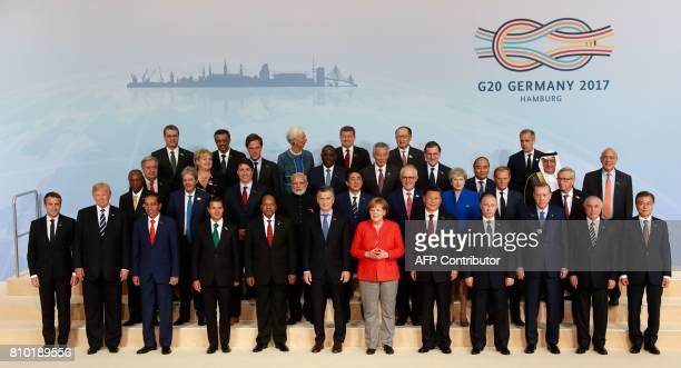Participants of the G20 summit in Hamburg northern Germany pose for a family photo on July 7 2017 Leaders of the world's top economies gather from...