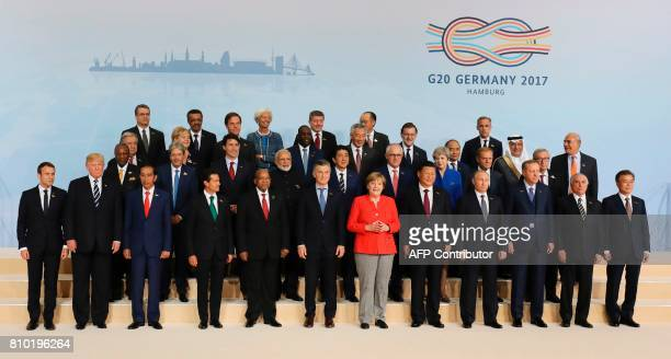Participants of the G20 summit in Hamburg northern Germany pose for a family photo on July 7 2017 Leaders of the world's top economies will gather...