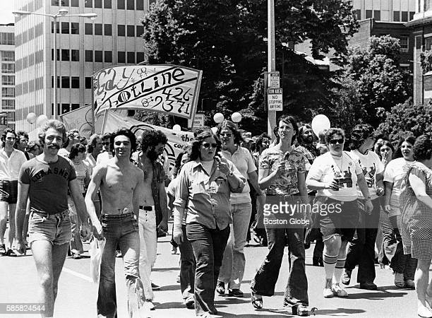 Participants of the Gay Pride celebration walk along Cambridge Street in Boston on June 21 1975