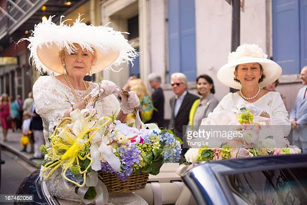 CONTENT] Participants of the Historic French Quarter Easter Parade riding down St Louis Street in New Orleans