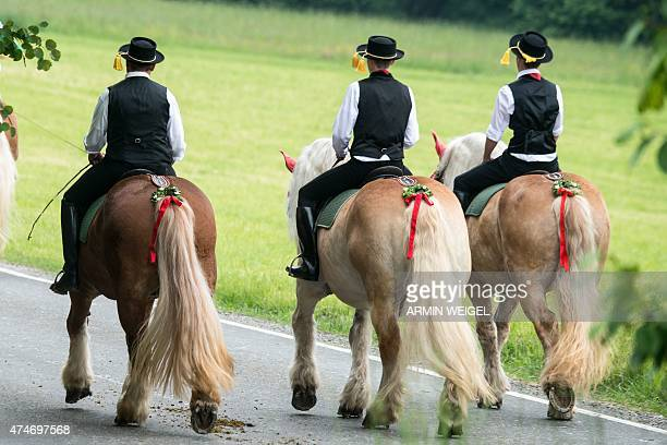 Participants of the Koetztinger Whitsun ride ride their horses near Bad Koetzting southern Germany on May 25 2015 The procession with 900 riders...