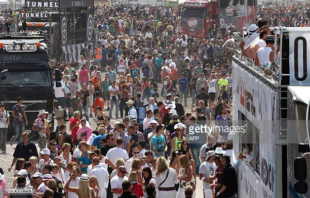 Participants of the Loveparade 2010 arrive at the festival in Duisburg western Germany on July 24 2010 The annual techno music event is expected to...