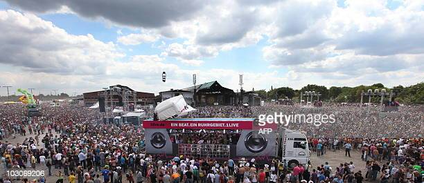Participants of the Loveparade 2010 dance at the festival in Duisburg western Germany on July 24 2010 The annual techno music event is expected to...