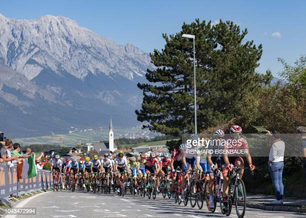 TOPSHOT Participants of the Men's Elite road race of the 2018 UCI Road World Championships compete during the race from Kufstein to Innsbruck on...