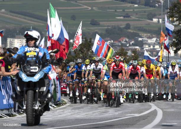 Participants of the Men's Elite road race of the 2018 UCI Road World Championships compete during the race from Kufstein to Innsbruck on September...
