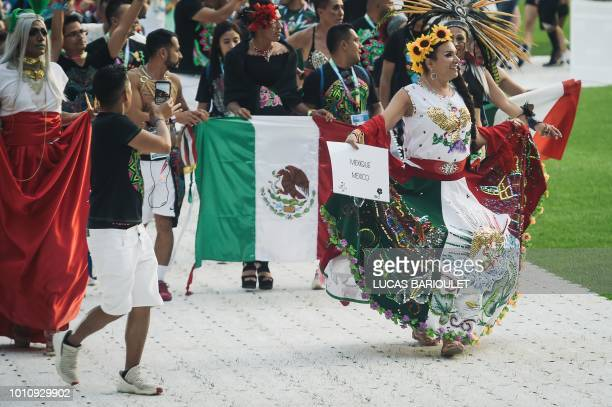 Participants of the Mexican team march onto the field during the opening ceremony of the 2018 Gay Games edition at the Jean Bouin Stadium in Paris on...