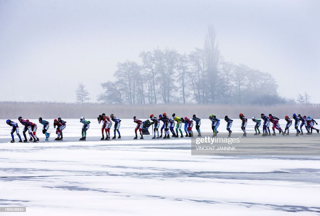 Participants of the National Championship Marathon at the Veluwemeer (Lake Veluwe) compete near Elburg, The Netherlands, on January 25, 2013. Due to cold, mist and bad ice a lot of the contestants did not make it to the finish line. netherlands out