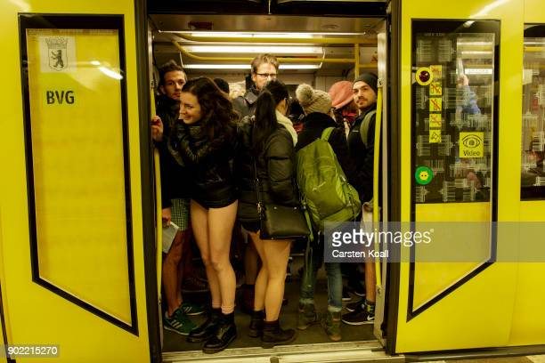 Participants of the No Pants Subway Ride By Odlo ride a commuter train on January 7, 2018 in Berlin, Germany. The annual event, in which participants...