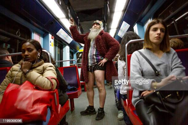 Participants of the No Pants Subway Ride ride a train on January 12, 2014 in Lisbon, Portugal. The annual event, in which participants board a subway...