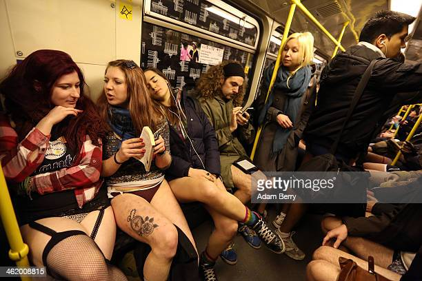 Participants of the No Pants Subway Ride ride a train on January 12 2014 in Berlin Germany The annual event in which participants board a subway car...