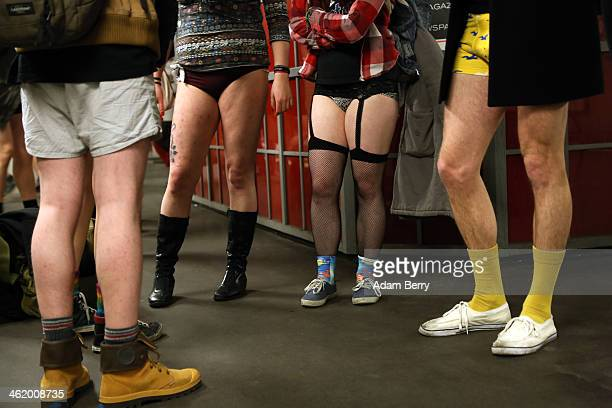 Participants of the No Pants Subway Ride wait for a train on January 12, 2014 in Berlin, Germany. The annual event, in which participants board a...