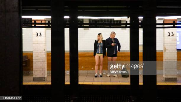 Participants of the No Pants Subway Ride wait for the train at the NYC subway system on January 12, 2020 in New York City. The annual event, in which...