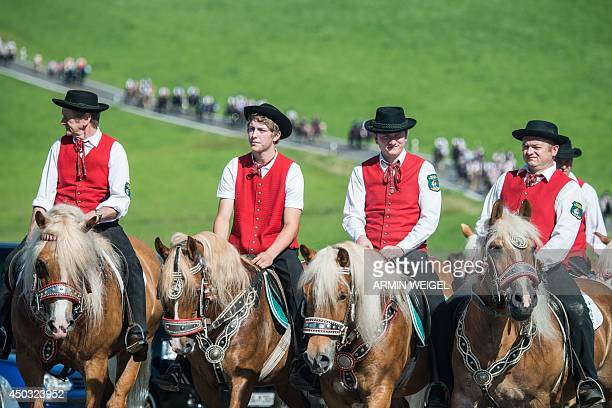 Participants of the Pentecostal horse ride parade on June 9 2014 near Bad Koetzting Germany The procession with around 900 riders is one of the...