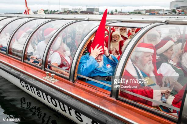 Participants of the Santa Claus World Congress attend a canal tour in Copenhagen Denmark on July 24 2017 The first Santa Claus World Congress was...