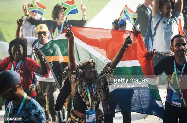 Participants of the South African team march onto the field during the opening ceremony of the 2018 Gay Games edition at the Jean Bouin Stadium in...
