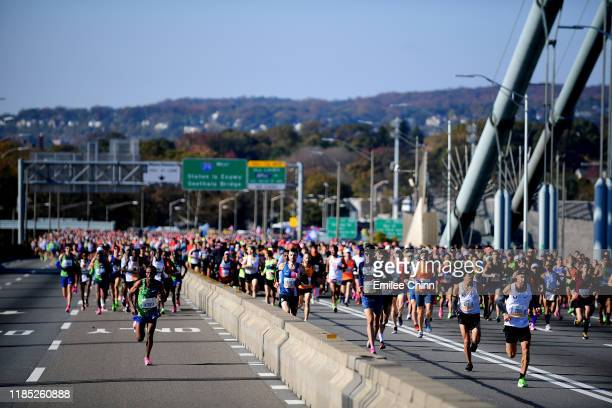 Participants of the TCS New York City Marathon run over the Verrazzano Bridge at the start of the race on November 03 2019 in the Staten Island...