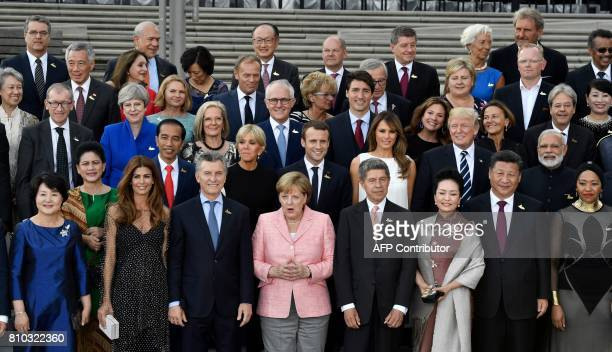 Participants of the the G20 Summit and their spouses pose for a family photo prior to a concert at the Elbphilharmonie concert hall during the G20...