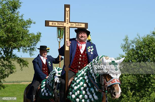 Participants of the traditional Pentecostal parade ride horses at the route near a Bavarian village Bad Koetzting southern Germany on June 9 2014...