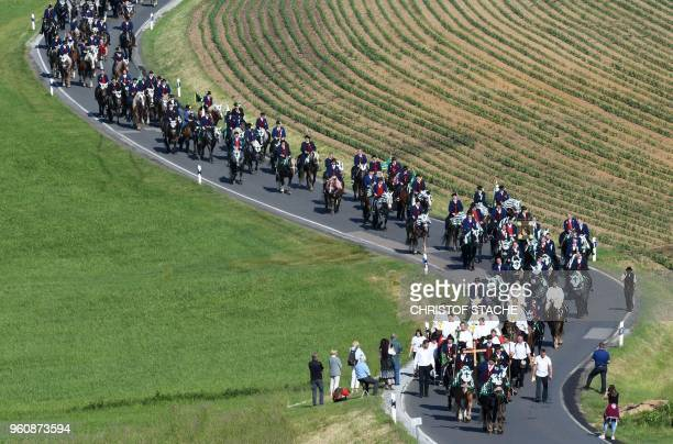 Participants of the traditional Pentecostal parade ride on horses near the Bavarian village of Bad Koetzting southern Germany on May 21 2018 Hundreds...