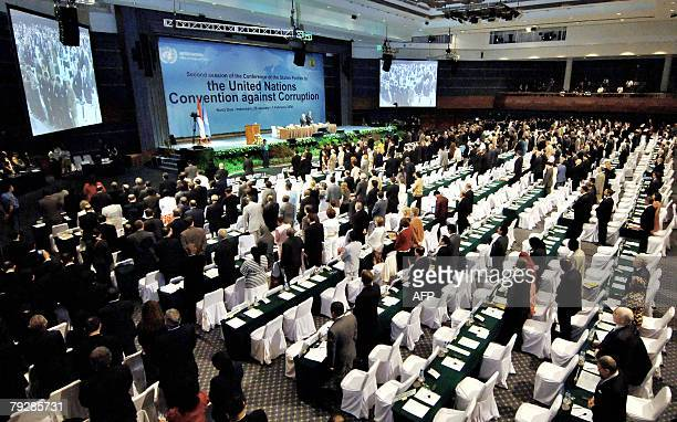 Participants of the United Nations Convention Against Corruption observe a minute of silence to pay their respect to late former president Suharto in...