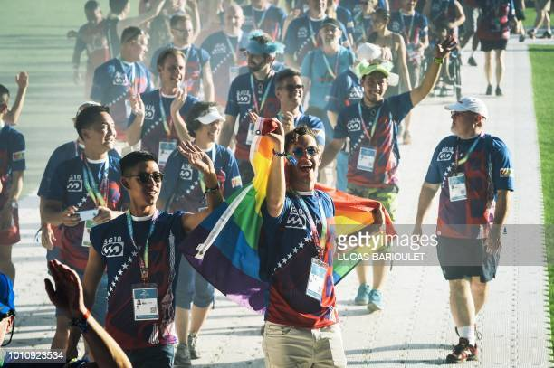 Participants of the US team march onto the field during the opening ceremony of the 2018 Gay Games edition at the Jean Bouin Stadium in Paris on...