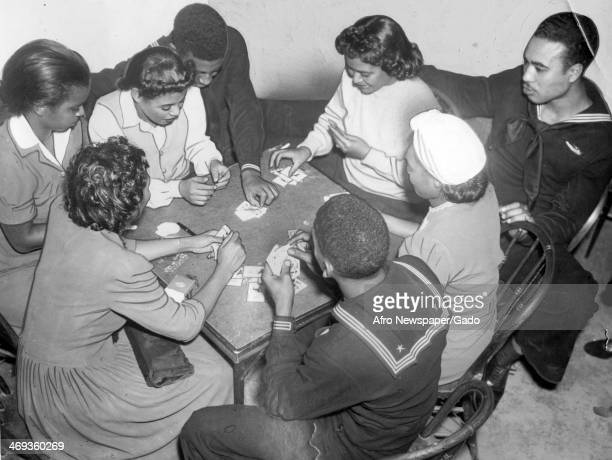 Participants of the USO program play cards, Washington, DC, March 23, 1946.