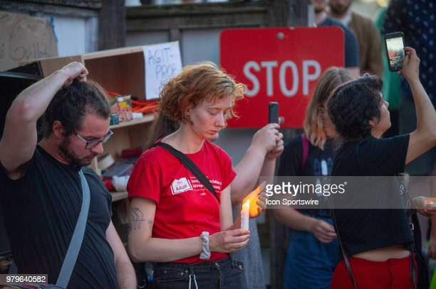 Participants of the vigil at OccupyICEPDX take a few minutes to meditate in silence just in front of the ICE Portland Headquarters in SW Maccadam on...