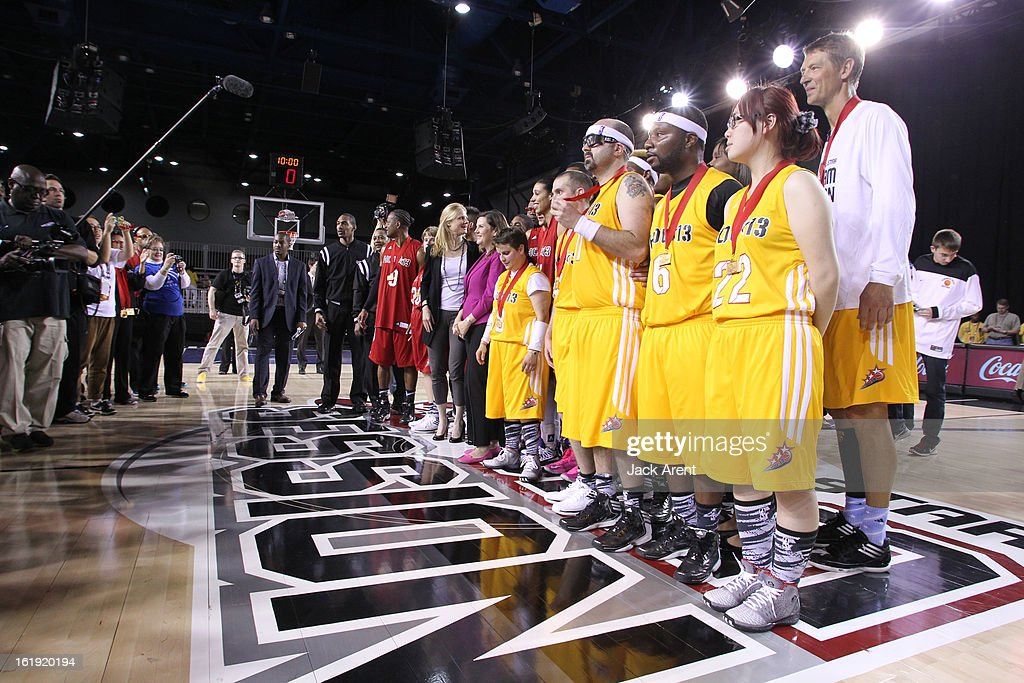 Participants of the West All-Stars are presented with medals after the NBA Cares Special Olympics Unified Sports Basketball Game on Center Court at Jam Session during the NBA All-Star Weekend on February 17, 2013 at the George R. Brown Convention Center in Houston, Texas.