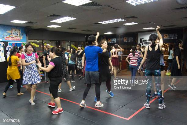 Participants of the #WomanStrong seminar organised by Krav Maga Global Singapore practice a selfdefence technique on March 8 2018 in Singapore