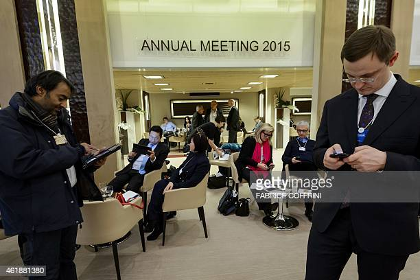 Participants of the World Economic Forum annual meeting are seen at the Congress center on January 21 2015 in Davos Global business leaders are very...