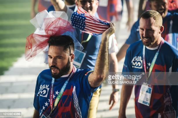 Participants of theUS team march onto the field during the opening ceremony of the 2018 Gay Games edition at the Jean Bouin Stadium in Paris on...