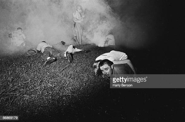 Participants on the Meredith Mississippi March are teargassed by the Mississippi Highway Patrol near the town of Canton June 1966 The march began...