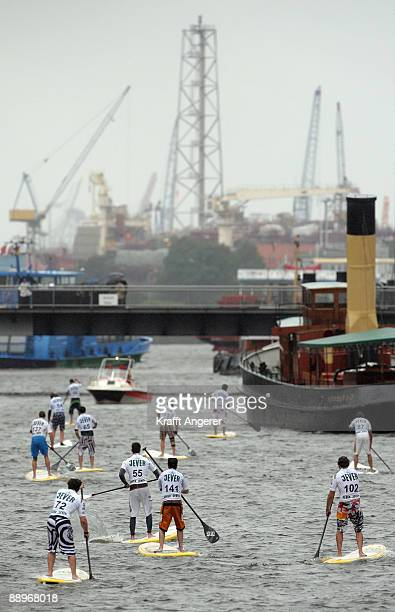 Participants on their standup paddleboards are seen during day one of the Jever SUP World Cup 2009 on July 10 2009 in Hamburg Germany