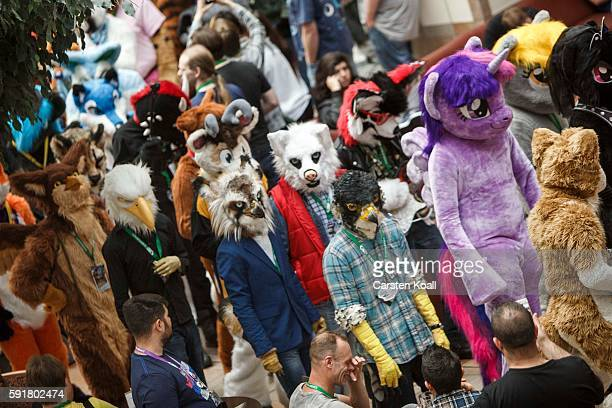 Participants or furries as they prefer to be called walk in the Estrel hotel lobby after a march on the second day of the 2016 Eurofurence furries...
