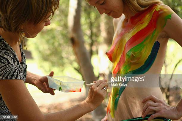 Participants paint their bodies in Sydney Park before the start of the World Naked Bike Ride Australia Sydney leg on March 15 2009 in Sydney...