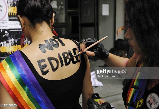 Participants paint their body during Slut Walk to protest against any form of sexual harassment of any gender in public places at Jaduvpur University...
