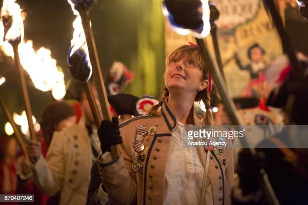 Participants parade with torches through the town of Lewes East Sussex England during the annual bonfire night procession is held by the Lewes...