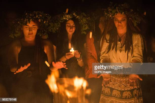 Participants participate in a ritual during the Beltane feast of Fire next to Krakau Mound in Krakow The Beltane Fire Festival is an annual...