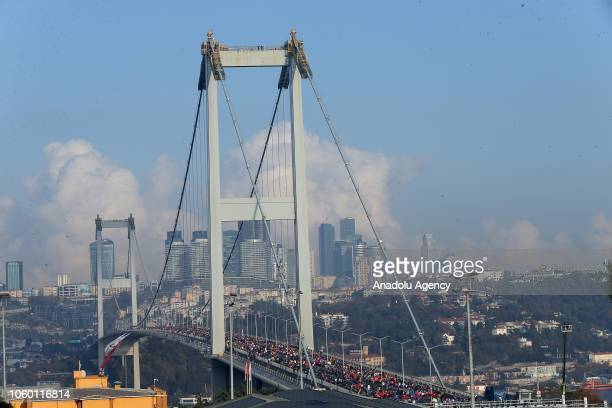 Participants pass over Istanbuls July 15 Martyrs Bridge competing in the World's only intercontinental marathon 'Vodafone 40th Istanbul Marathon' in...