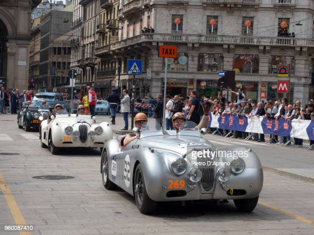Participants pass through the city centre of Milan during 1000 Miles Historic Road Race on May 19 2018 in Milan Italy