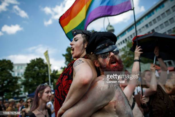 Participants perfom at the 40th Christopher Street Day gay pride march on July 28 2018 in Berlin Germany Known as CSD the event attracts thousands of...