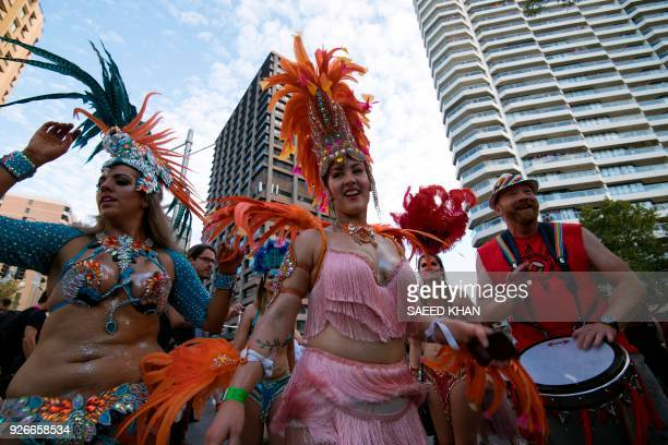 Participants perform a belly dance during the annual Gay and Lesbian Mardi Gras parade in Sydney on March 3 2018 Rainbow colours beamed from faces...