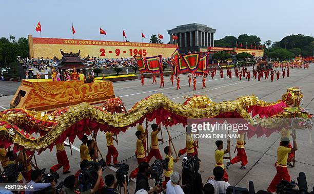 Participants perform a dragon dance during a parade in front of the mausoleum of late president Ho Chi Minh founder of today's communist Vietnam as...