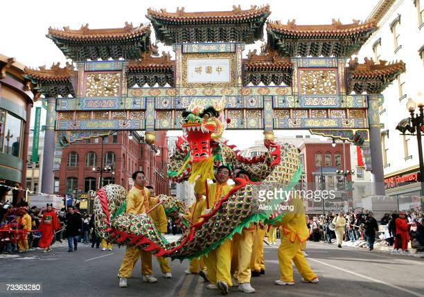 Participants perform a dragon dance during the annual Chinese New Year Parade February 18 2007 in the Chinatown section of Washington DC Chinese...