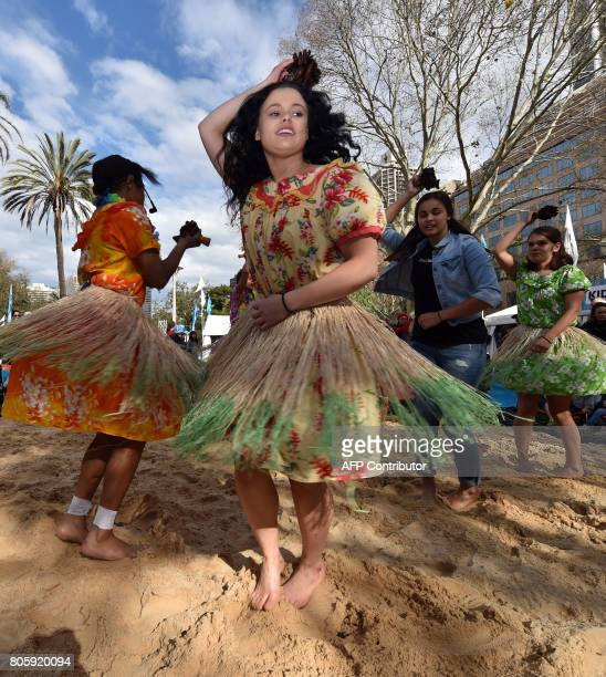 Participants perform a traditional Aboriginal dance at Sydney's Hyde Park on July 3 2017 The week long annual event with the theme of 'our languages...